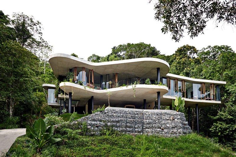 Casa moderna con fachada curva de concreto Casa en Australia